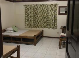 OYO 606 House Of Rose, hotel in Puerto Princesa