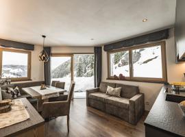 AURELA MOUNTAIN CHALETS, apartment in Selva di Val Gardena