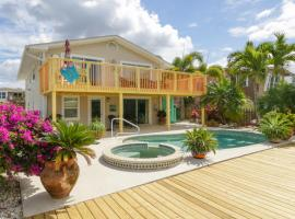 Waterfront close to Times Square Pier. Fishing dock & gazebo with hammock, vacation rental in Fort Myers Beach
