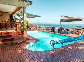 Apartment with 2 bedrooms in SaintPaul with wonderful sea view shared pool furnished terrace 10 km from the beach, hôtel à Saint-Paul