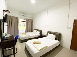 OYO 90087 Warisan Motel, hotel in Sipitang