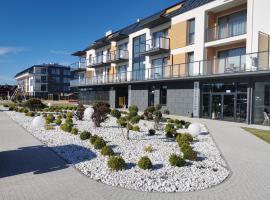 Apartament Rodzinny Deluxe Suite B56 w budynku z basenem Baltin Blu, apartment in Sarbinowo