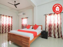 OYO 28470 Intimate Tourist Home, hotel in Kozhikode