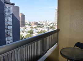 Accommodation Sydney Studio with balcony apartment, íbúð í Sydney