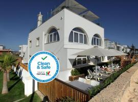 Golden Beach Guest House, hotel in Faro