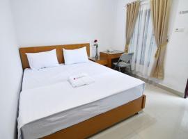 Rich Guesthouse, hotel di Paalmerah