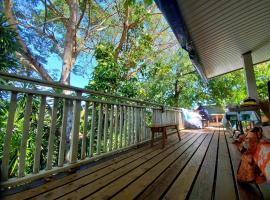 Outdoor Covered terrace Backpackers Kohutahia Lodge pick-up needed 7 minutes by car from airport and town, B&B in Faaa