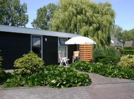 Fijn tuinhuis nabij het Haarlemmermeerse Bos, budget hotel in Hoofddorp
