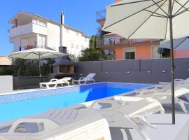 Family friendly apartments with a swimming pool Podstrana, Split - 4859, hotel with pools in Podstrana