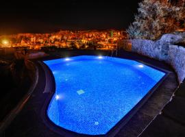 Cappadocia Caves Hotel، فندق في غوريمِ