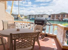 Relaxing Waterfront Villa 230 E, villa in Jolly Harbour