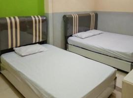 KoolKost Female near Rumah Sakit Mitra Siaga Tegal ( Minimum Stay 6 Nights ), guest house in Tegal
