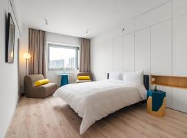 Stey 798 Serviced Apartment Boutique Hotel, отель в Пекине