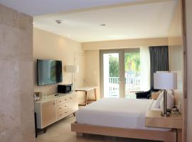 The Mill Resort and Suites, hotel in Palm-Eagle Beach