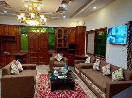 Hotel Defence Inn, hotel near Jinnah International Airport - KHI, Karachi