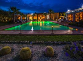 Villa with 7 bedrooms in Annakhil Marrakech with private pool enclosed garden and WiFi, hotel in Graoua