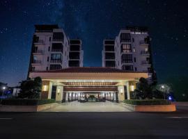 Sanya Fuhaitang Holiday Hotel, отель в Санье