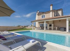 Stylish Villa with pool and fenced garden,ideal for relaxing family holidays, vacation home in Loborika