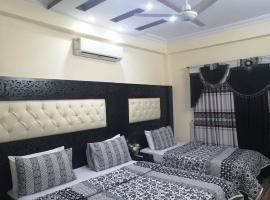 Primrose Cottages, отель в Карачи