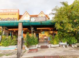 OYO 75304 Riverside Guesthouse, отель в городе Кхаулак