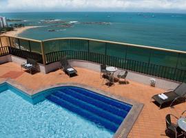 Apartamento com varanda de frente para o mar da Praia da Costa, hotel em Vila Velha