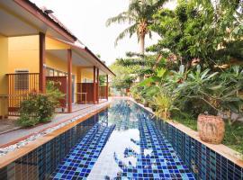 OYO 75342 Ban Elephant Blanc Bungalow, Hotel in Strand Kata