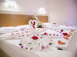 Grand Atilla Otel, отель в городе Аланья, рядом находится Пляж Клеопатры