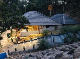 Misty Rain Holiday Inn, hotel in Madikeri