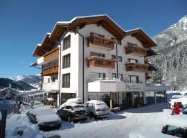 Hotel Flora Alpina, отель в Кампителло-ди-Фасса