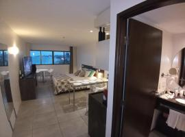 Flat Suíte Premium 35m2 Vista Mar com Água Mineral e Cozinha em Hotel Home Service, hotel em Maceió