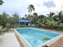 CAPITAL O75345 Praewa Villas Naiyang Phuket, отель в городе Най-Янг-Бич