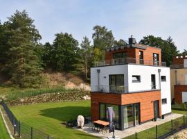 5 Sterne Ferienhaus-See-Sauna-Kamin-Garten-Hund, holiday home in Krakow am See