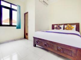 Vaccinated Staff - SPOT ON 90152 Garuda Bima Residence Syariah, hotel in Tangerang