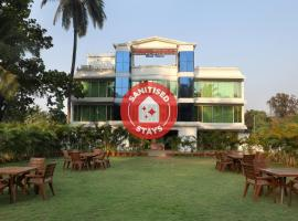 OYO 12817 White house beach resort, hotel in Alibaug