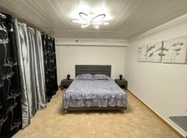 Appartement dans maison à Corbelin proche Walibi, hôtel à Corbelin
