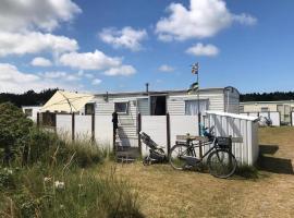 Knusse caravan camping Duinoord 300m van strand, self catering accommodation in Nes