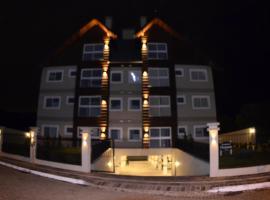 Maravilhoso Apartamento 2 Suites Gramado, apartment in Gramado