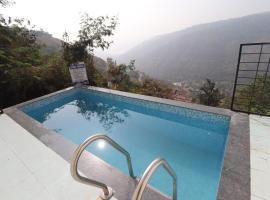 Infiniti pool rooms at Panchghani, room in Panchgani