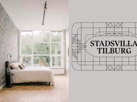 Stadsvilla Tilburg Suite Ernst, workspace garden and kitchen available, apartment in Tilburg