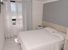 Suíte perfeita para Casal em Areia Preta Natal por Carpediem, hotel with pools in Natal