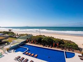 Aptos em hotel pé na areia nos Ingleses SLA, hotel en Florianópolis