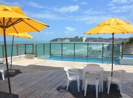 Araça Flat - Beira mar - Apto508 lateral com vista parcial, hotel perto de Museu Popular da Cultura, Natal