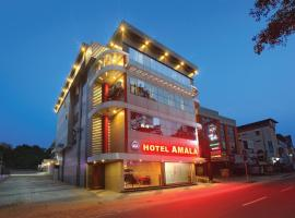 HOTEL AMALA, hotel en Pathanāmthitta