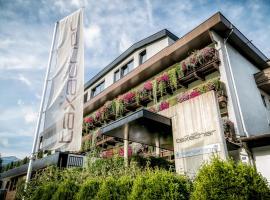 Hotel Taxacher, отель в городе Кирхберг-ин-Тироль