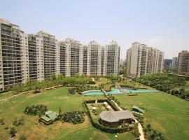 Relocatte Homes - Premium APT in resort style Condo with lots of open space, accessible hotel in Gurgaon