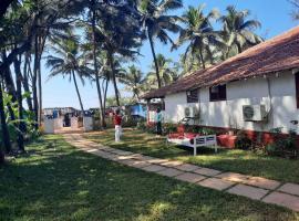 Dhuni Resorts Anjuna Goa, отель в Анжуне