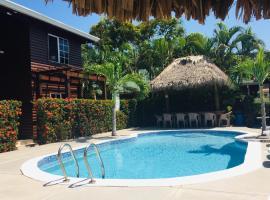 Hotel y Cabañas Playa Caribe, отель в городе Тела