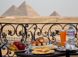 Pyramids Planet Hotel, hôtel au Caire