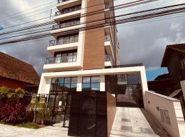 Loft no centro com Smart Tv, Ar e cozinha, apartment in Joinville