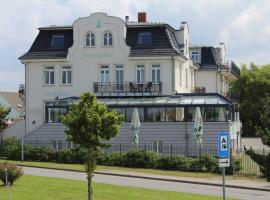 Pension Strandschloss Arielle, hotel with jacuzzis in Börgerende-Rethwisch